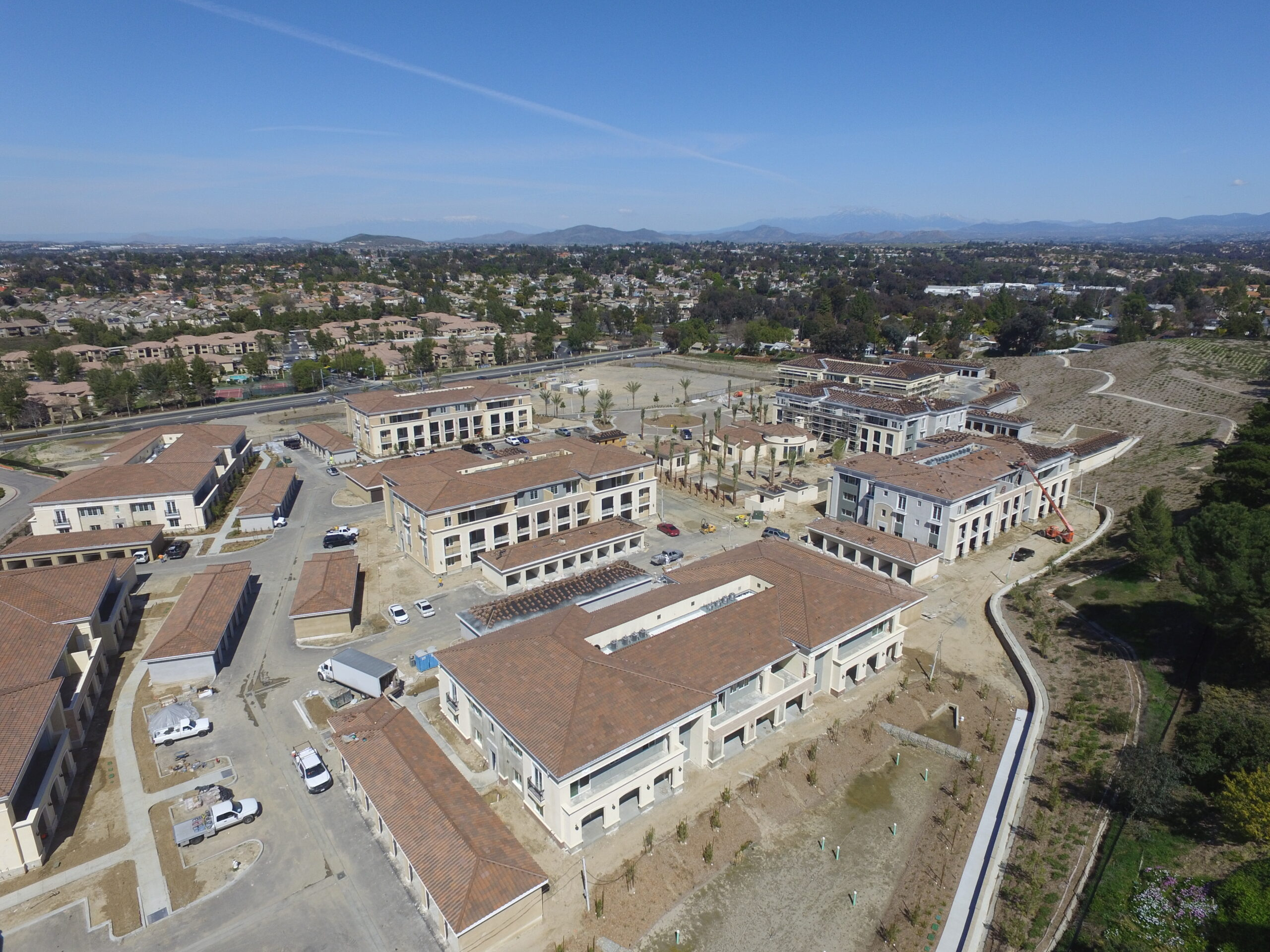 Pacific West Development Completes Stucco / Close to Complete with Leasing Office and First Buildings at Temecula Village Apartments